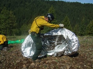 Deploying fire shelter, photo courtesy of goheroes.usa