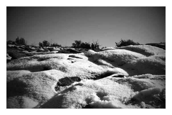 Slippery snow on slickrock