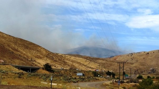 Arrival at the fire. When we were told to head up and await orders I looked around in disbelief at the sea of grass and sagebrush all around us and wondered where we would go for safety if the need arose.